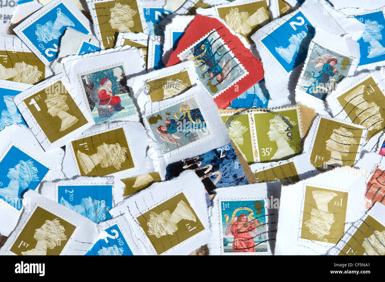 Assorted used British stamps. - Stock Image