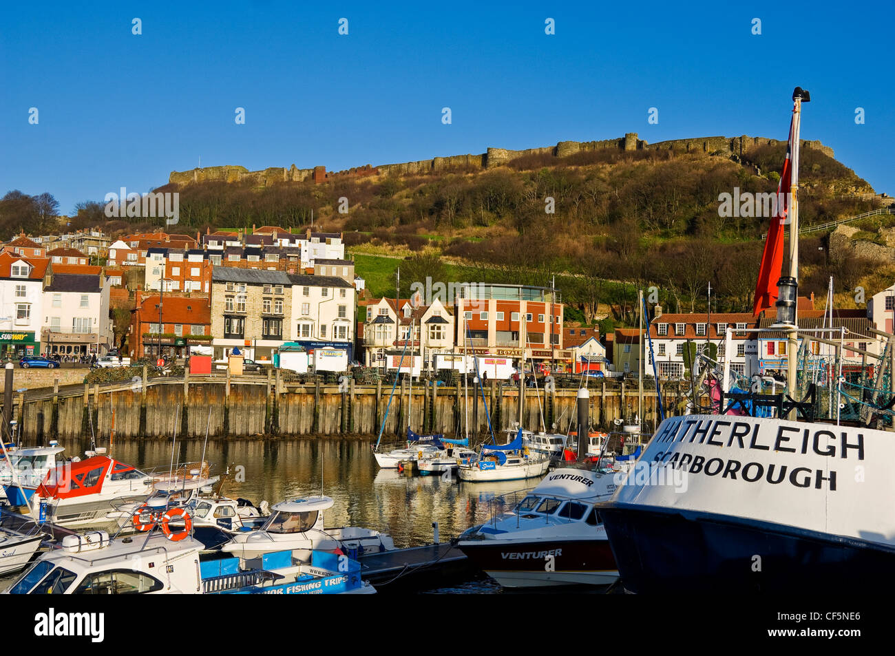 Deep sea trawler Hatherleigh moored in Scarborough Inner Harbour with the Castle in the background. - Stock Image