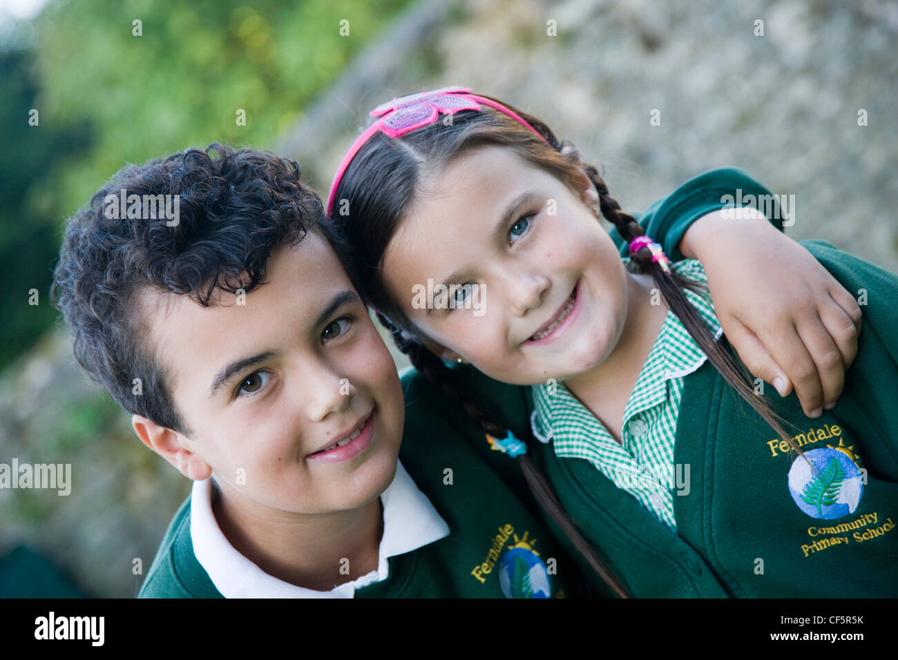 Schoolboy and schoolgirl in school uniform - Stock Image