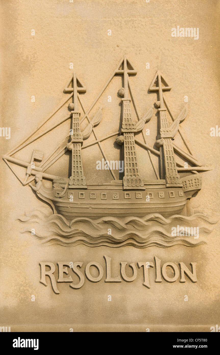 Stone carving of the ship Resolution on the base of the Captain James Cook statue which overlooks Whitby harbour. - Stock Image