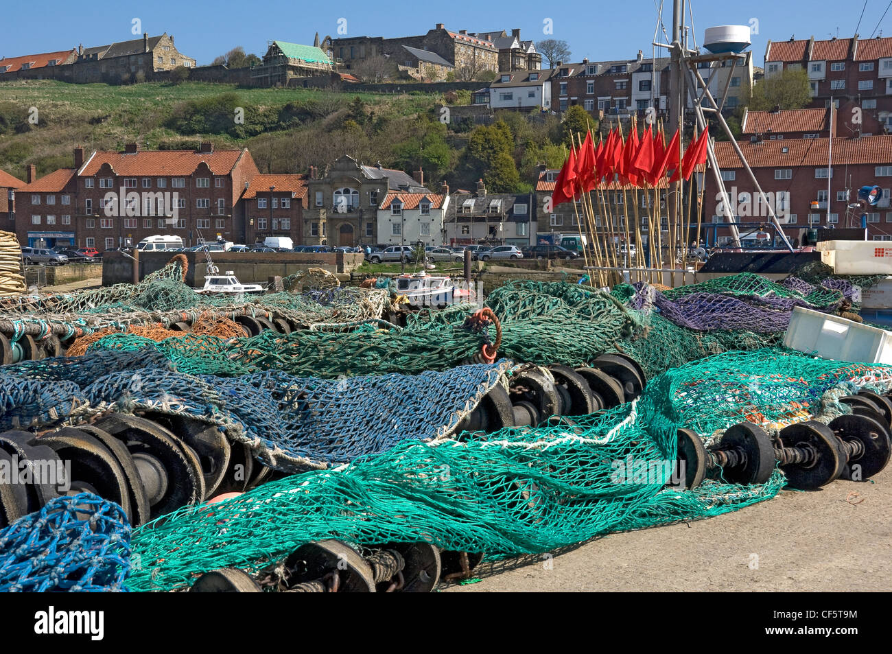 Trawling nets laid out on the Whitby quayside. - Stock Image