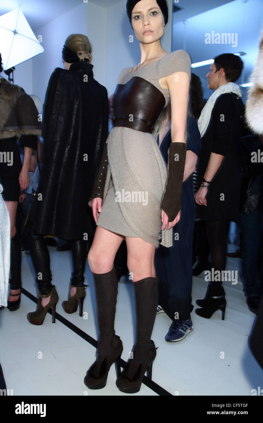 afd36e0754 Fendi Backstage Milan Ready to Wear Autumn Winter wearing short light brown wrap  sweater dress accessorized brown leather
