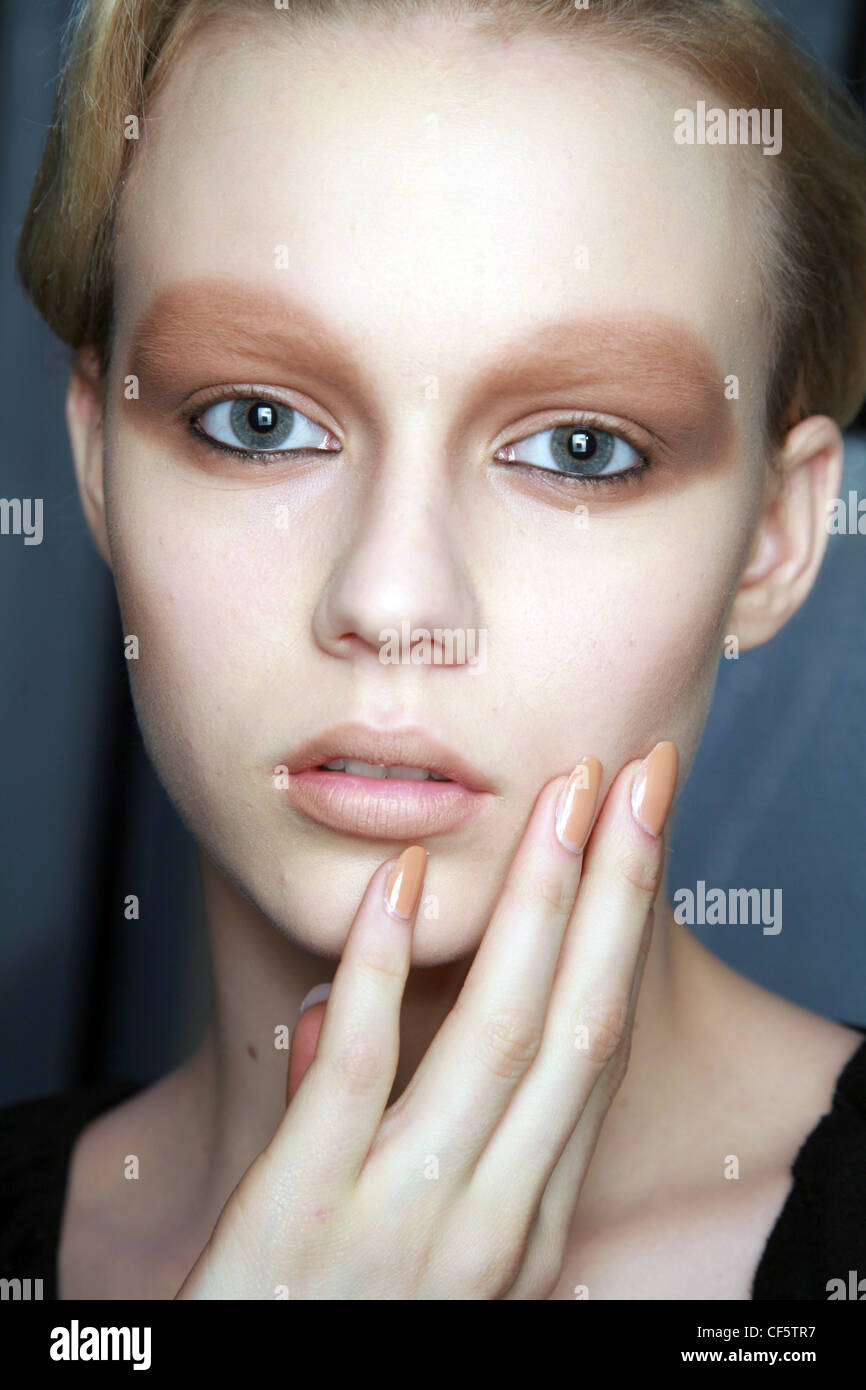 483794ad1cf6 Miu Miu Paris Backstage Ready to Wear Autumn Winter A female model thick  white foundation