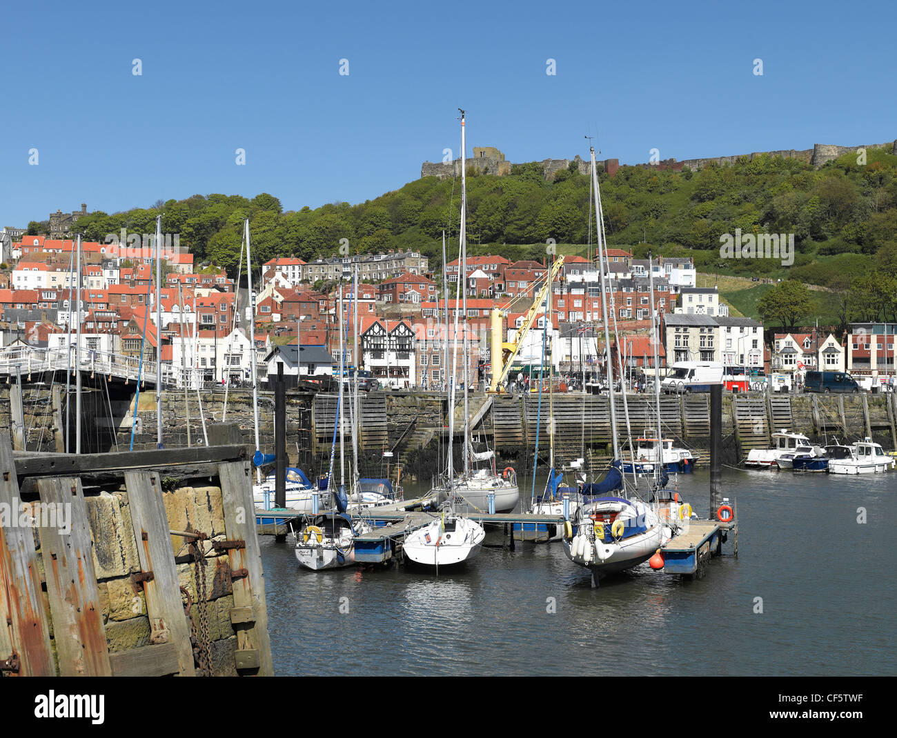 Small boats moored in Scarborough's Inner Harbour at low tide. Stock Photo