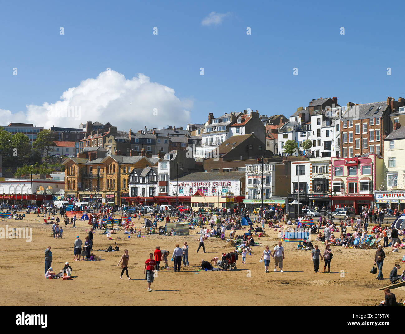 Holidaymakers enjoying the sunshine on South Bay beach. - Stock Image