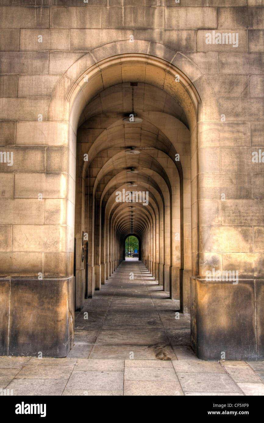 An arched walkway in Manchester Town Hall. - Stock Image