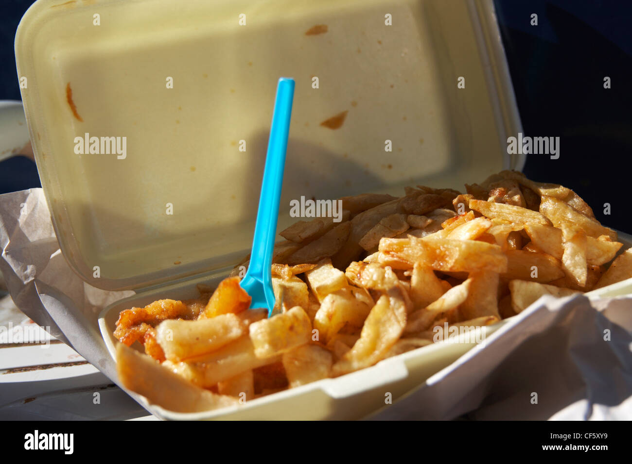 A close up of fish and chips in a tray on Morecambe sea front. - Stock Image