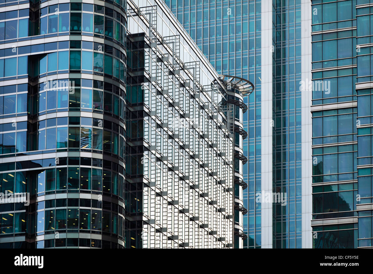 Bright, gleaming glass clad office buildings in Canary Wharf. - Stock Image
