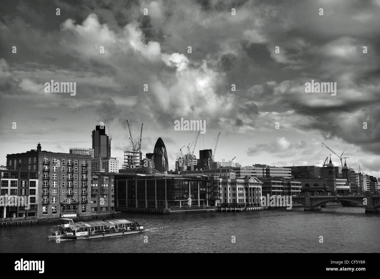 View across the River Thames towards iconic London landmarks, 'the Gherkin and Tower 42, (formerly known as - Stock Image