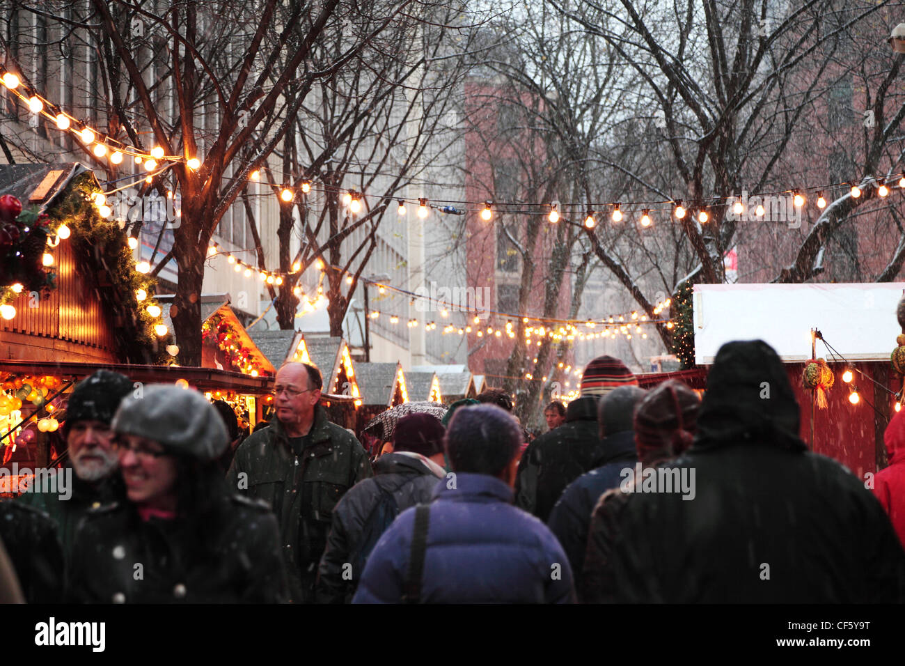 People shopping at the Christmas Market in Manchester on a cold Winter day. - Stock Image