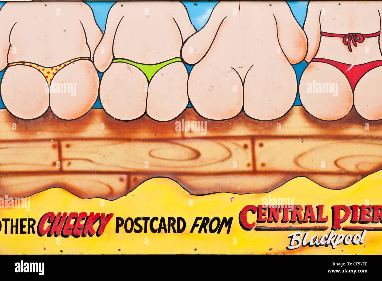 Blackpool Central Pier cheeky postcard sign. - Stock Image