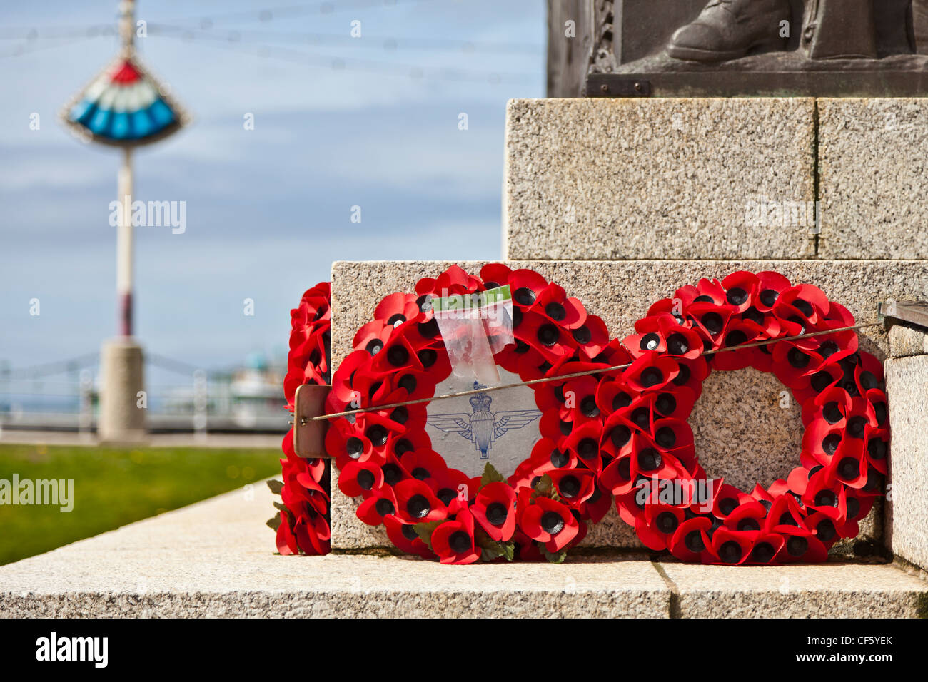 Poppy wreaths laid in remembrance at the foot of the war memorial on the seafront at Blackpool. - Stock Image