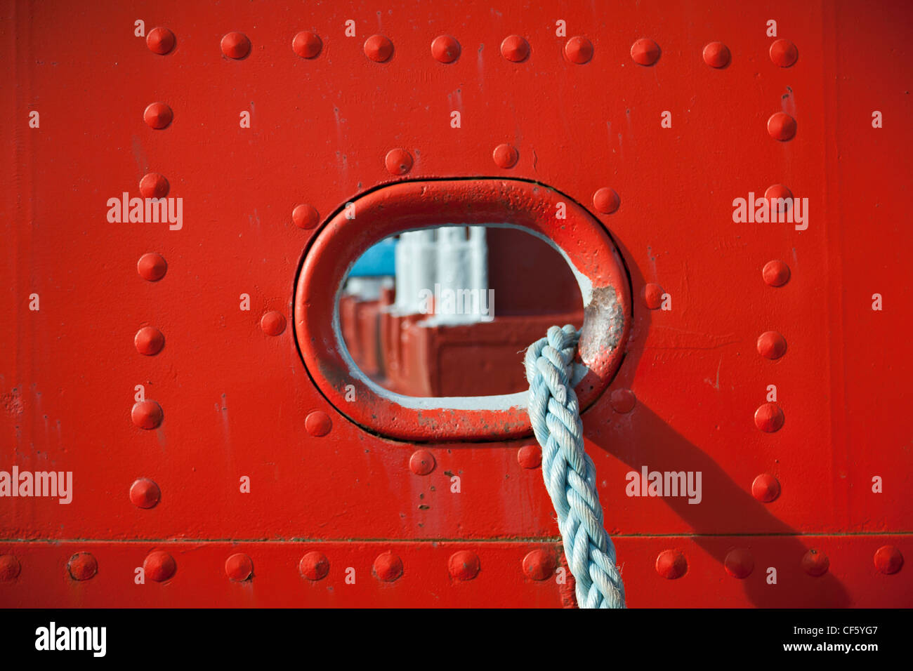 Portal and rope on the side of a ship. - Stock Image