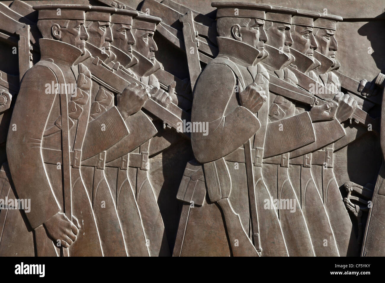 Sculpted bronze reliefs depicting an army on the move in a long march, on the Cenotaph in Liverpool. - Stock Image