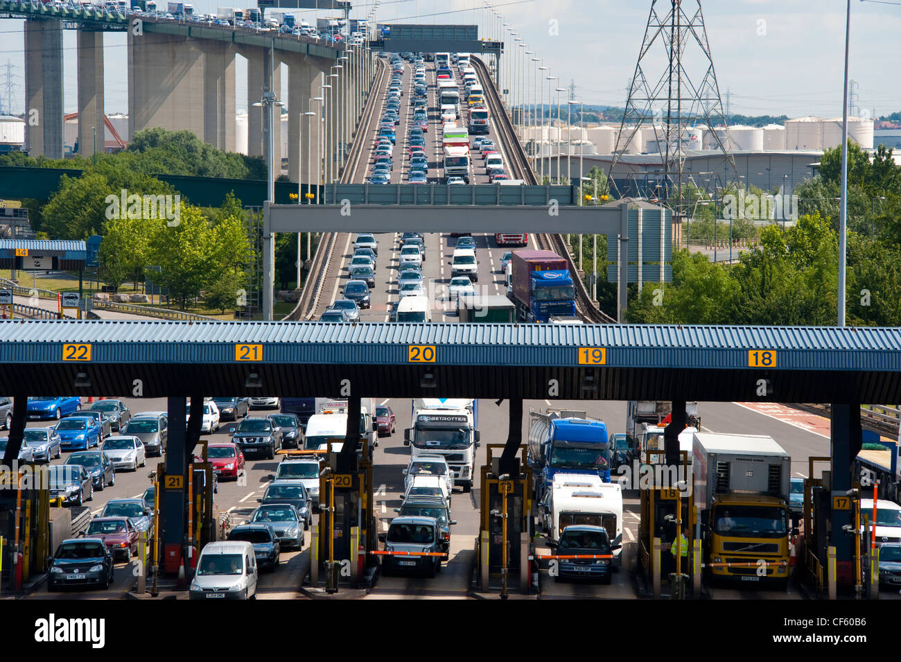 Traffic queueing at the toll booths at the end of the QE2 Bridge (Dartford River Crossing) as it moves into Kent - Stock Image