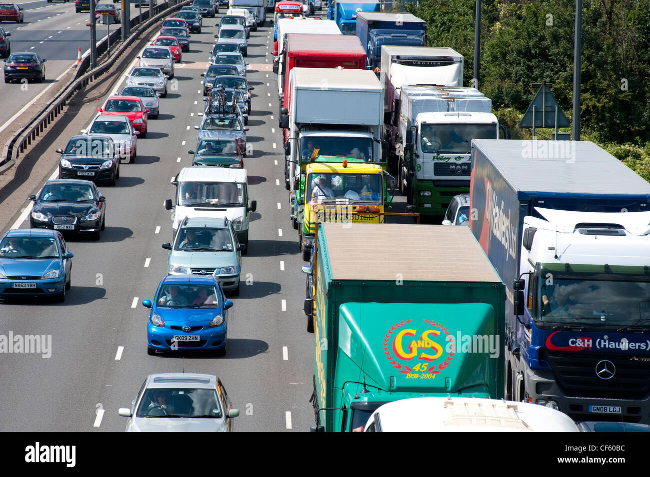 Traffic queues on the approach to the Dartford River Crossing from Kent into Essex. - Stock Image