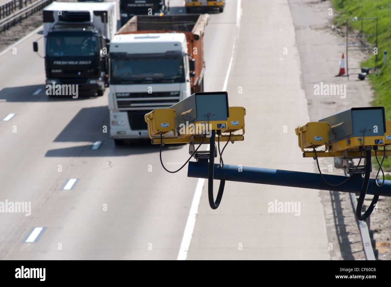 CCTV (closed circuit television) monitoring traffic on the M25 in Essex. The UK has the highest amount of CCTV surveillance - Stock Image