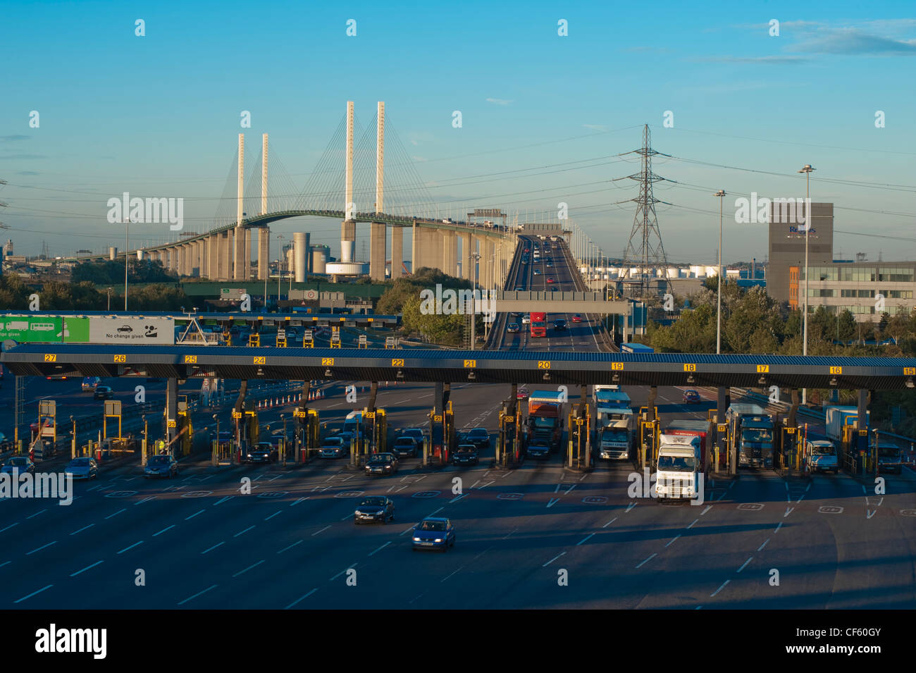 Traffic pulling away from the toll booths of the Dartford River crossing to enter Kent. - Stock Image