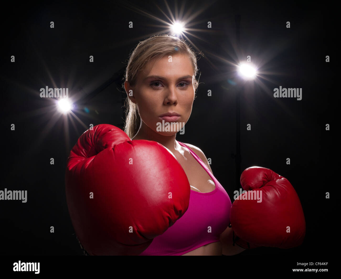 Female Boxer with boxing Gloves - Stock Image