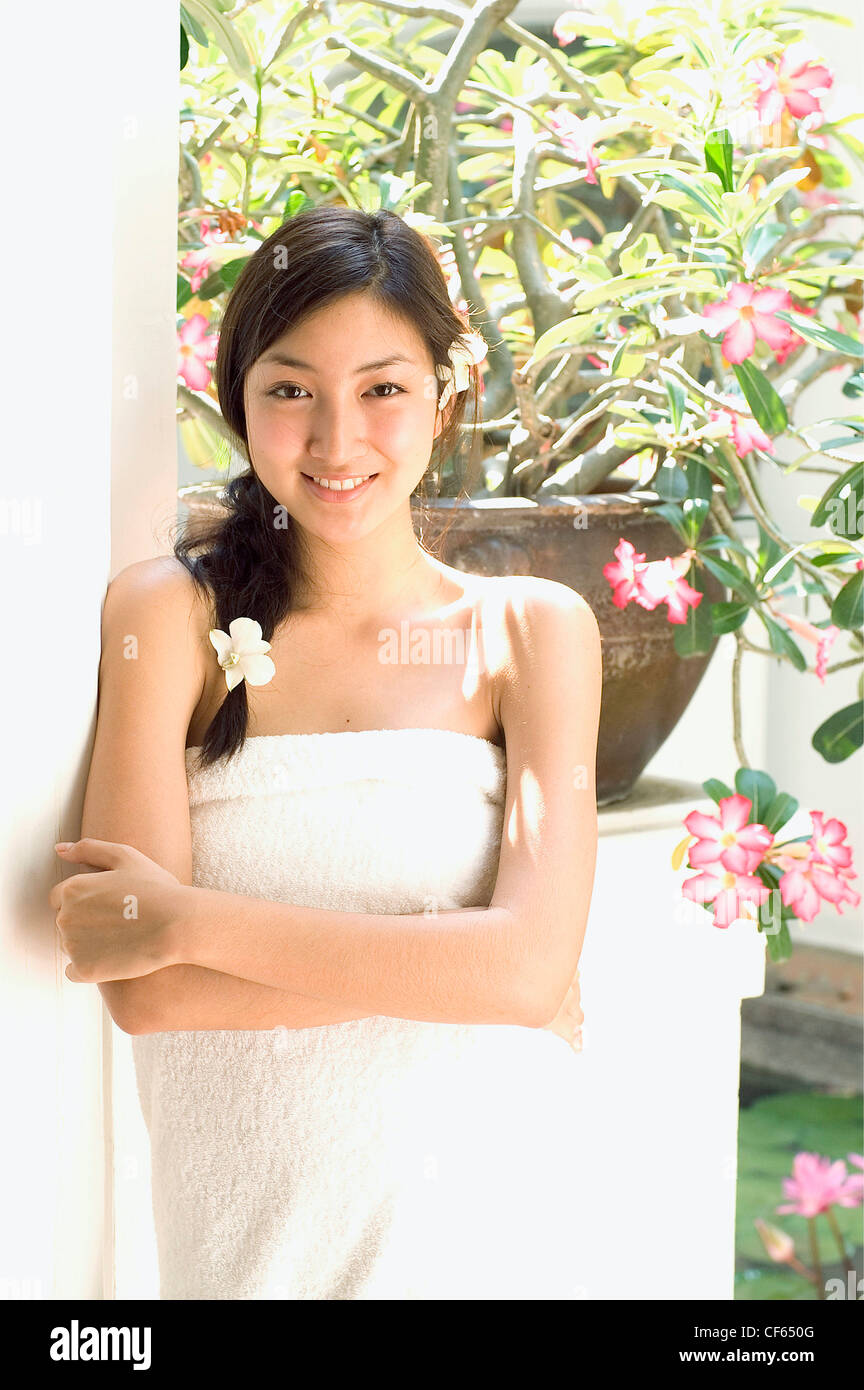 Female Long Black Hair Wearing White Towel And White Flowers In Hair