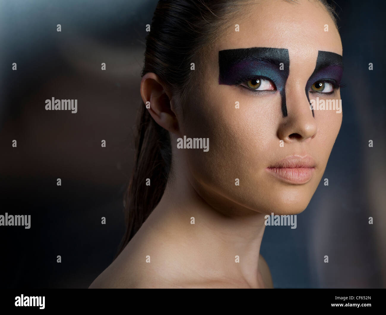 Futuristic makeup eyeshadow on Asian model - Stock Image