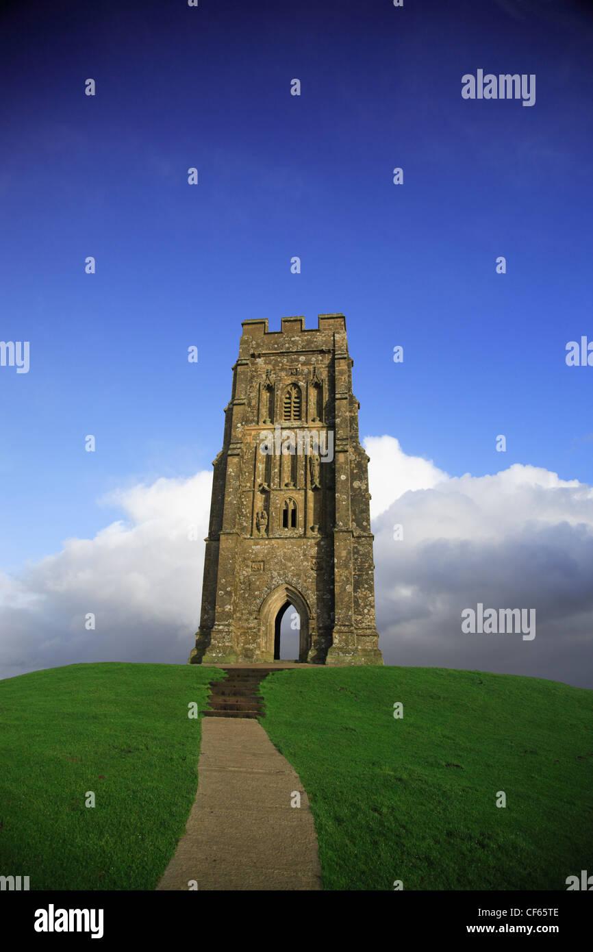 Glastonbury Tor against a vivid blue sky. - Stock Image