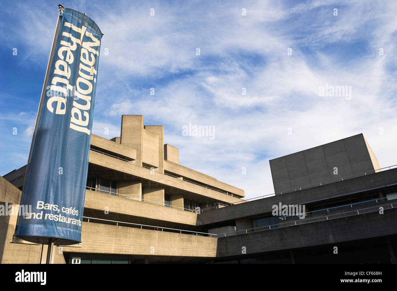 A large banner hanging outside the National Theatre on the South Bank. - Stock Image