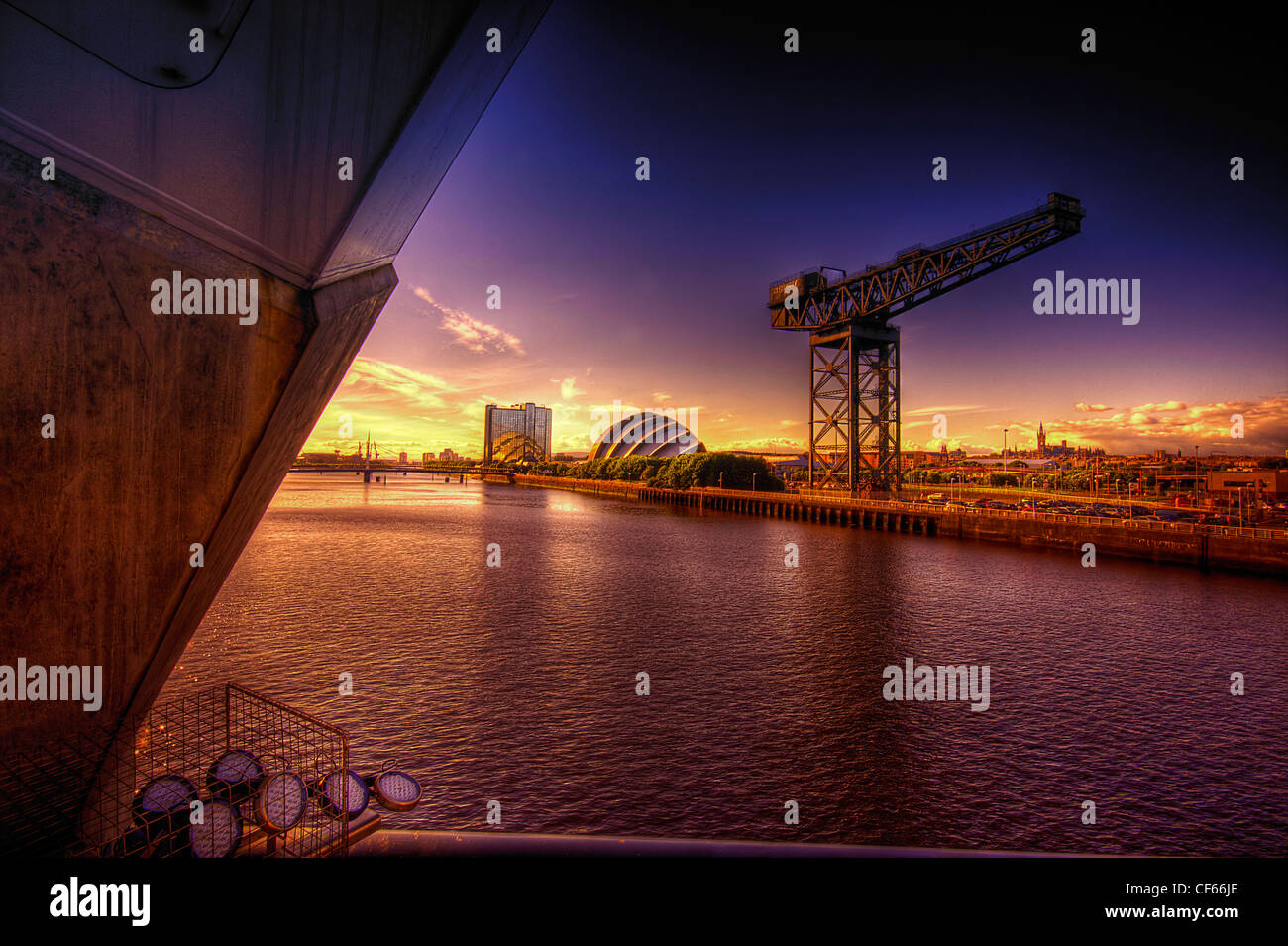 A view across the River Clyde toward the Finnieston Crane in Glasgow. - Stock Image