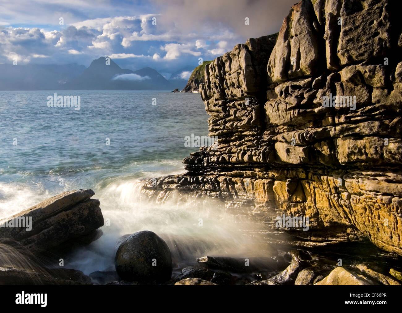 Waves crashing onto rocks at Elgol on the Isle of Skye. - Stock Image