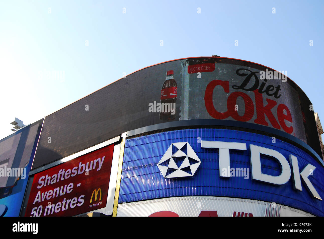 Advertising hoardings on buildings at Piccadilly Circus in London. - Stock Image