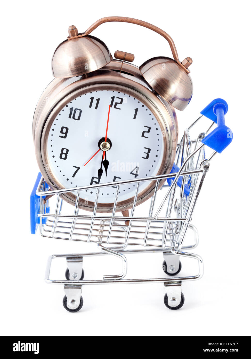 Old-styled alarm clock in small shopping cart. - Stock Image