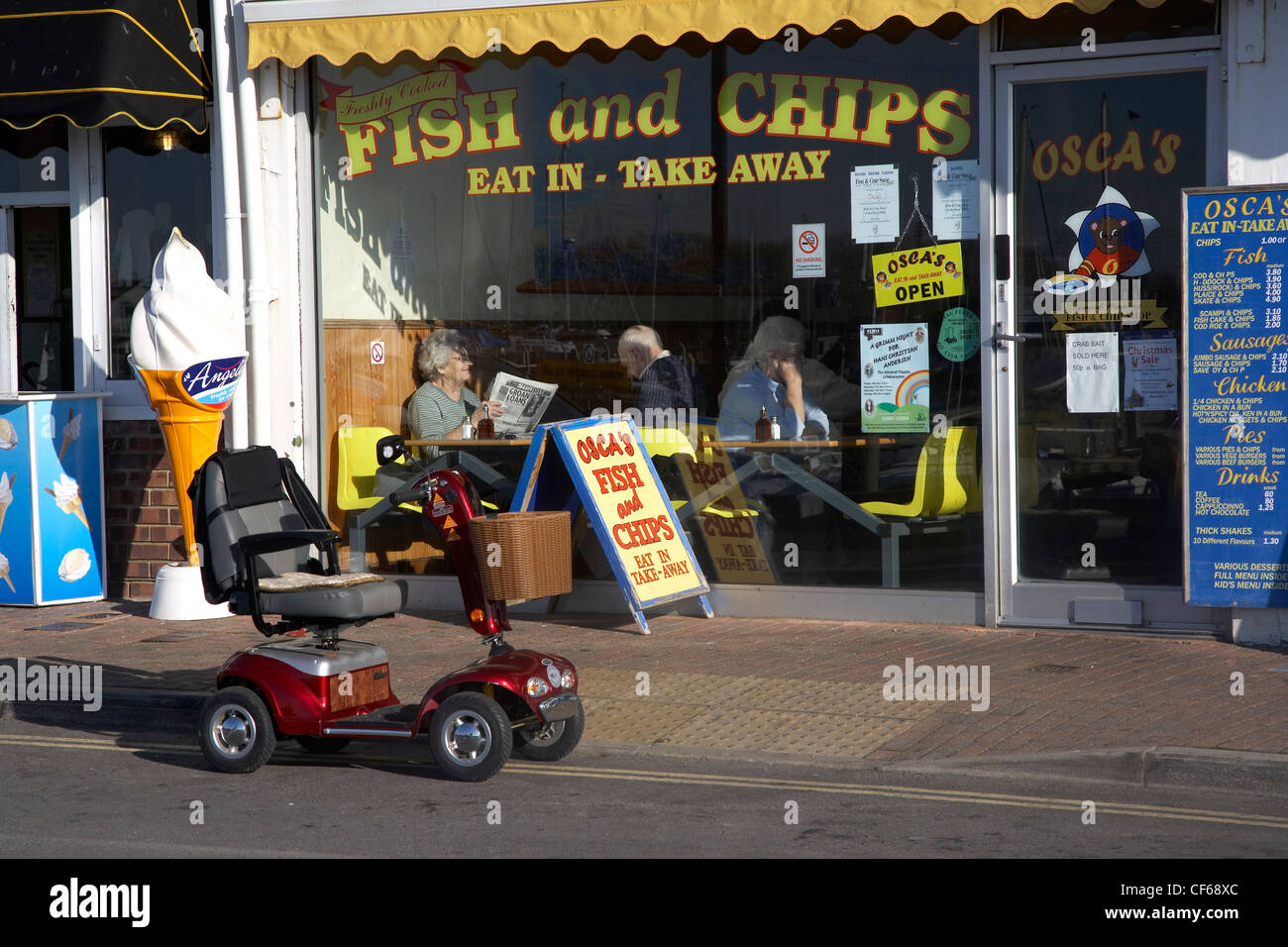 Exterior of a fish and chip restaurant. - Stock Image
