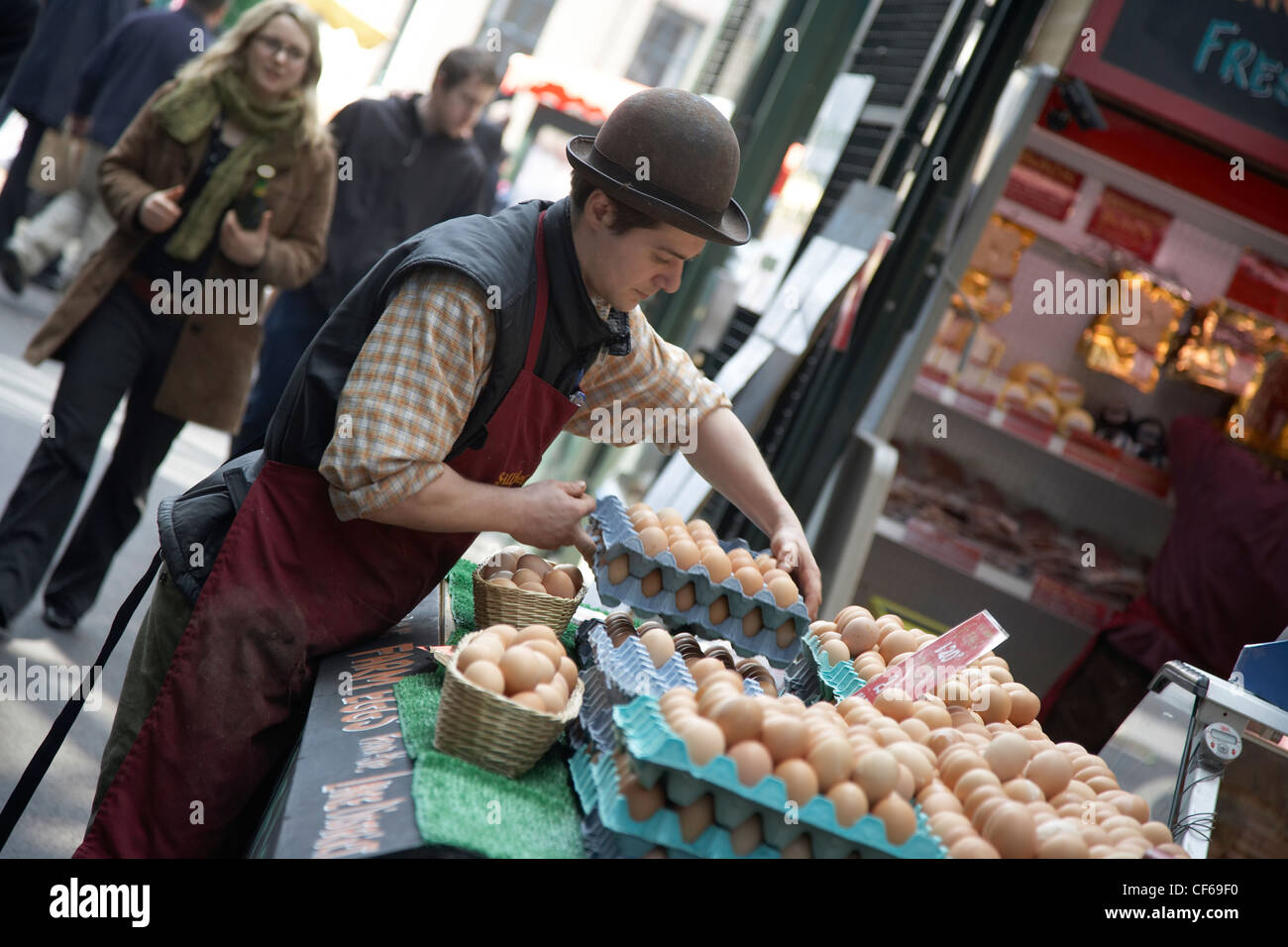 An interior view of stalls and customers at Borough Market. Stock Photo