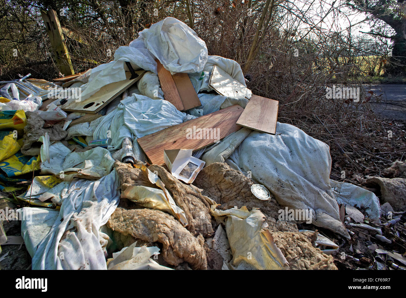 Fly tipping on country road - Stock Image