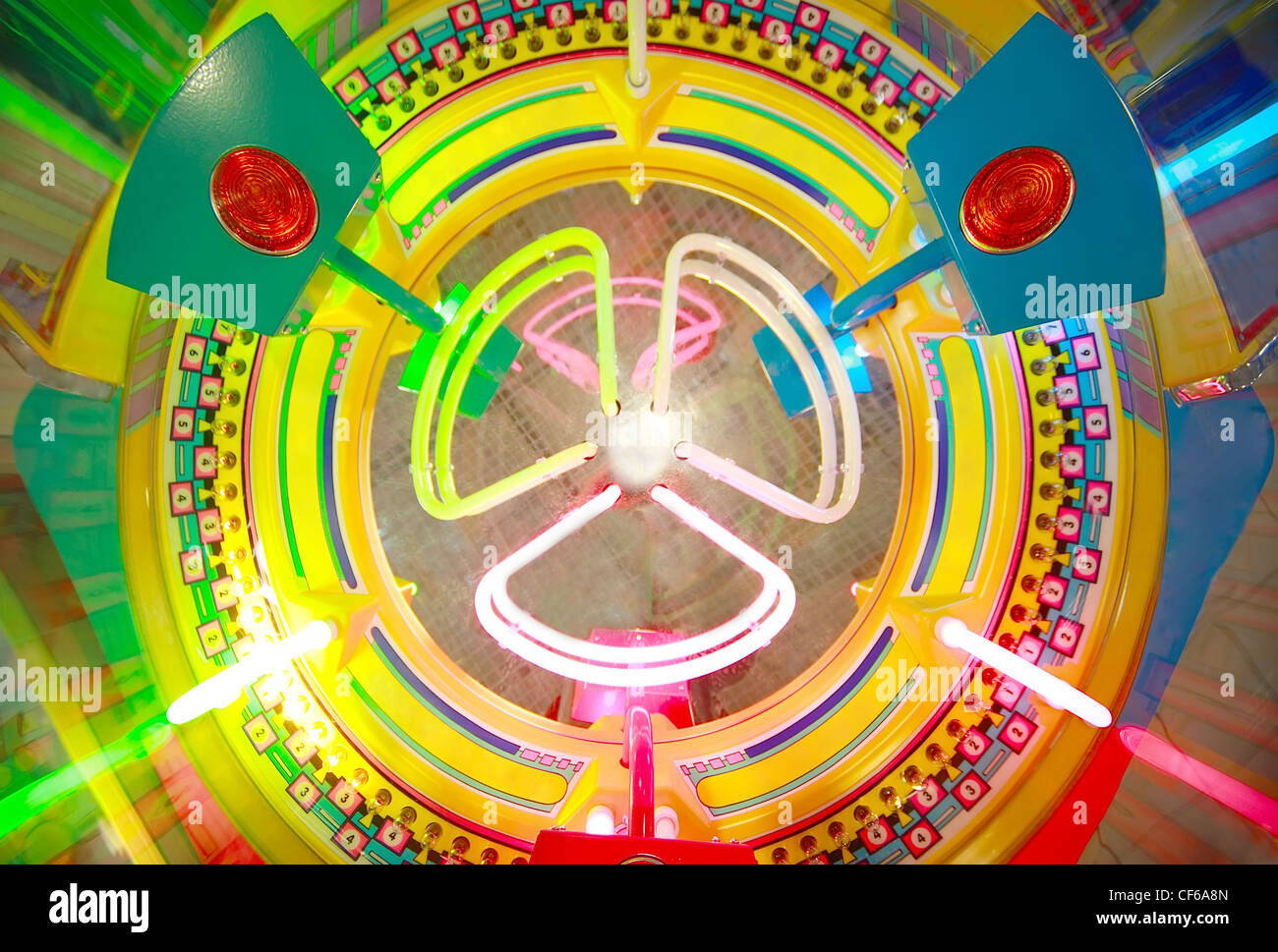 Close-up view of colorful electronic roulette in arcade machine - Stock Image