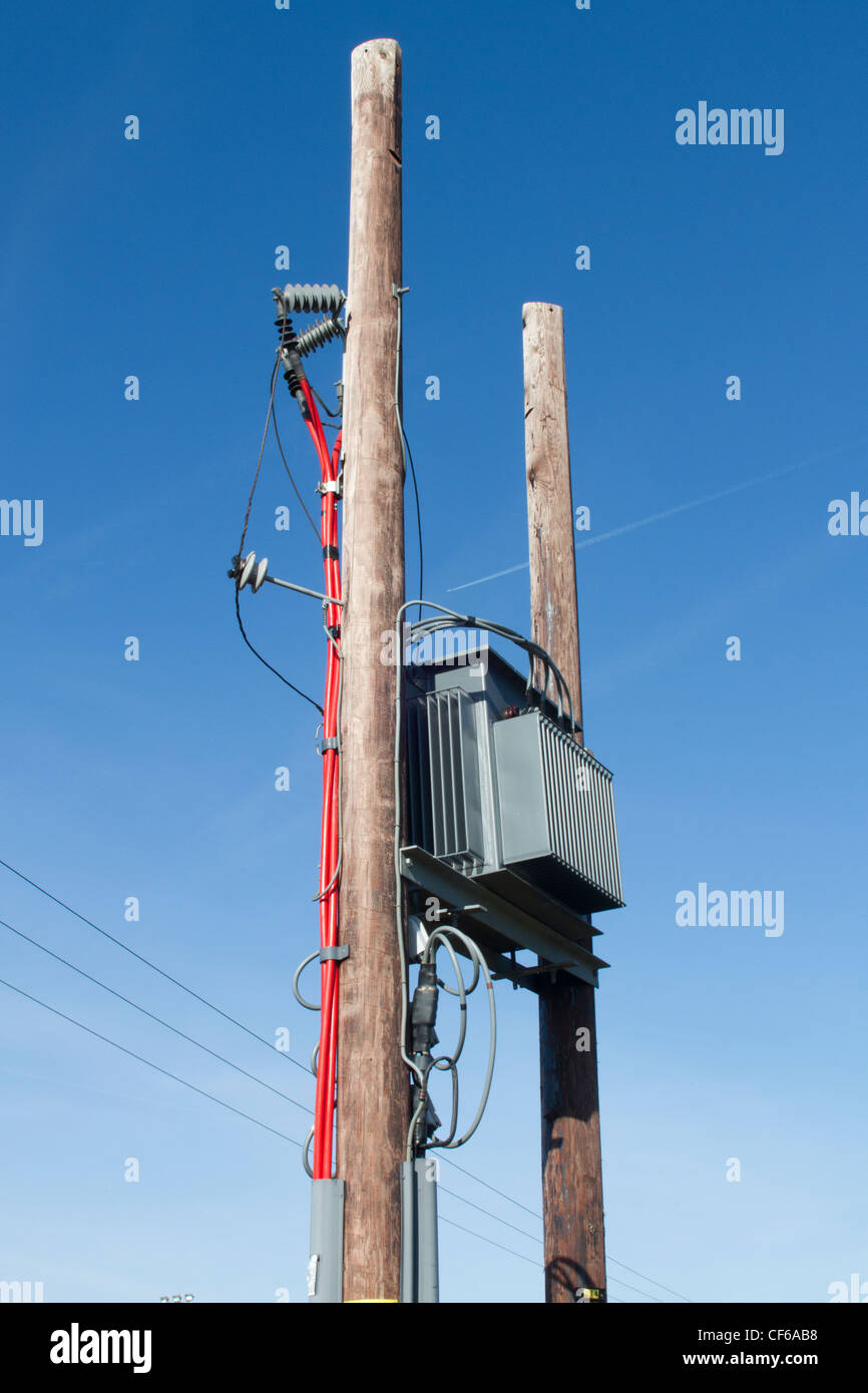 Mains electrical supply equipment on external supporting poles and transmission lines. - Stock Image