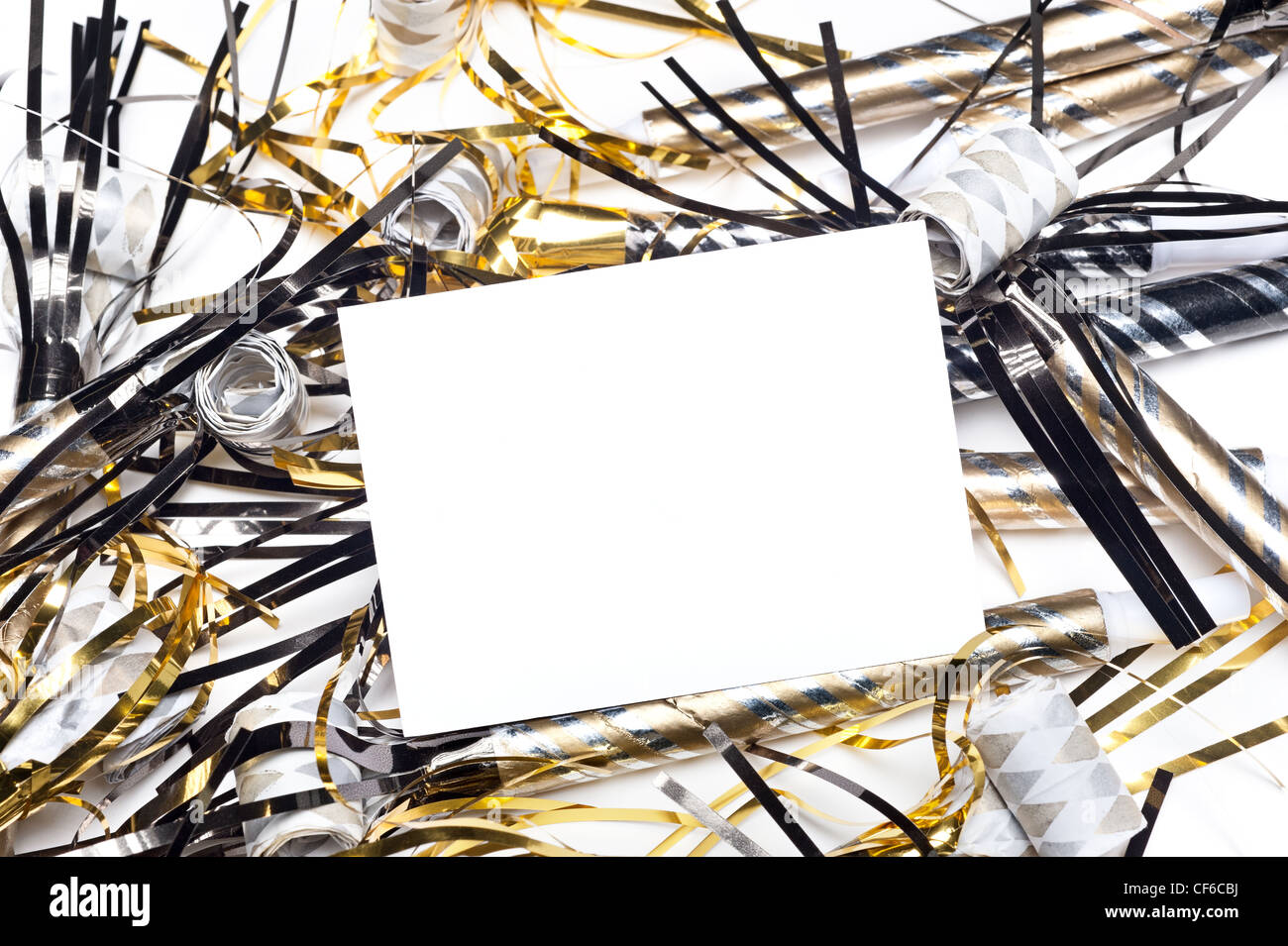 A blank party invitation with party blow horns and streamers. Card is blank for placement of copy. - Stock Image