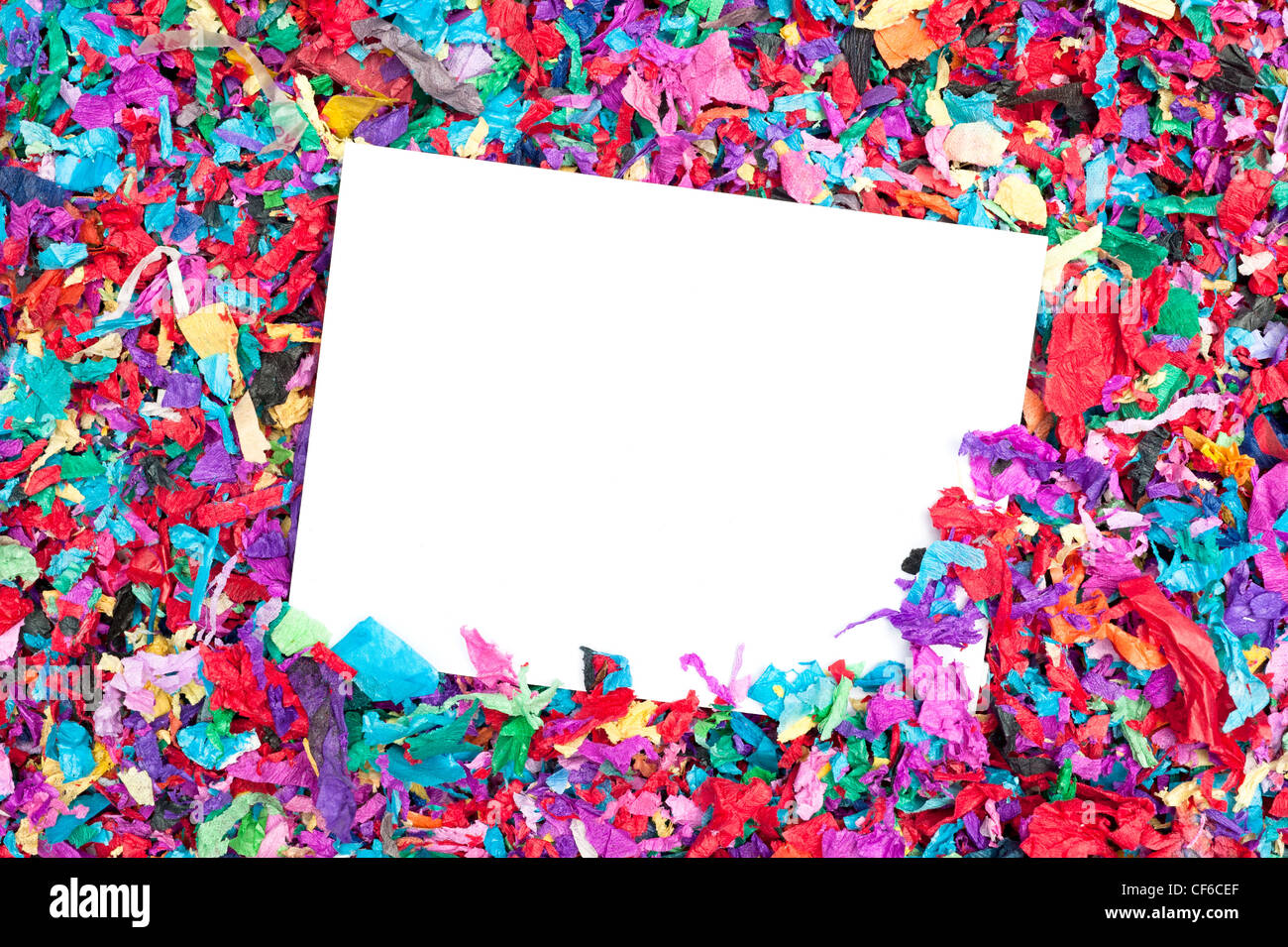 A blank invitation in a pile of colorful confetti. Good for any celebration event. Designers can place copy on the - Stock Image