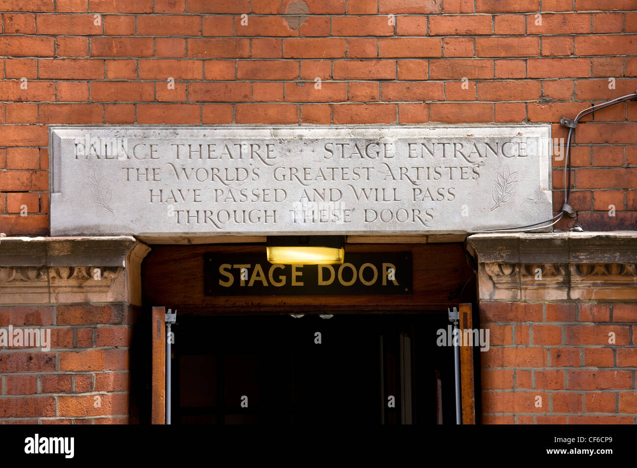 The stage door to the Palace theatre in the West End of London, above which is a stone inscribed with the words - Stock Image