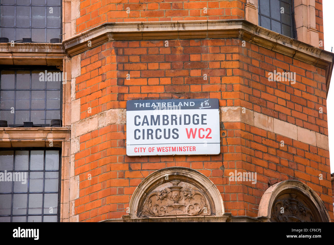 Cambridge Circus street sign with Theatreland written above. - Stock Image