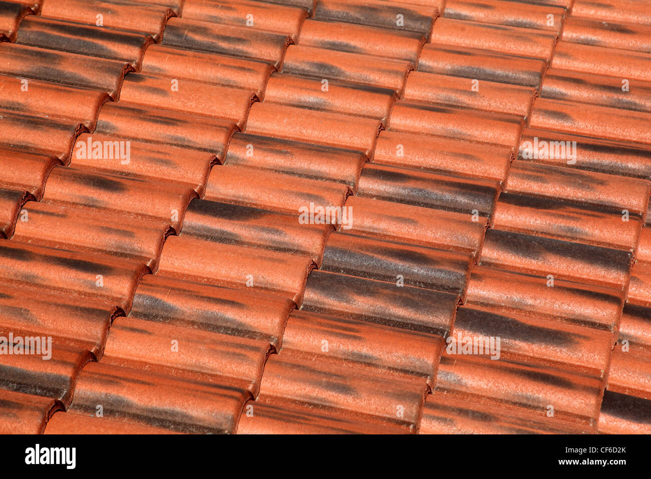 Old terracotta tile roof, detailed structure view at an angle the tiles - Stock Image