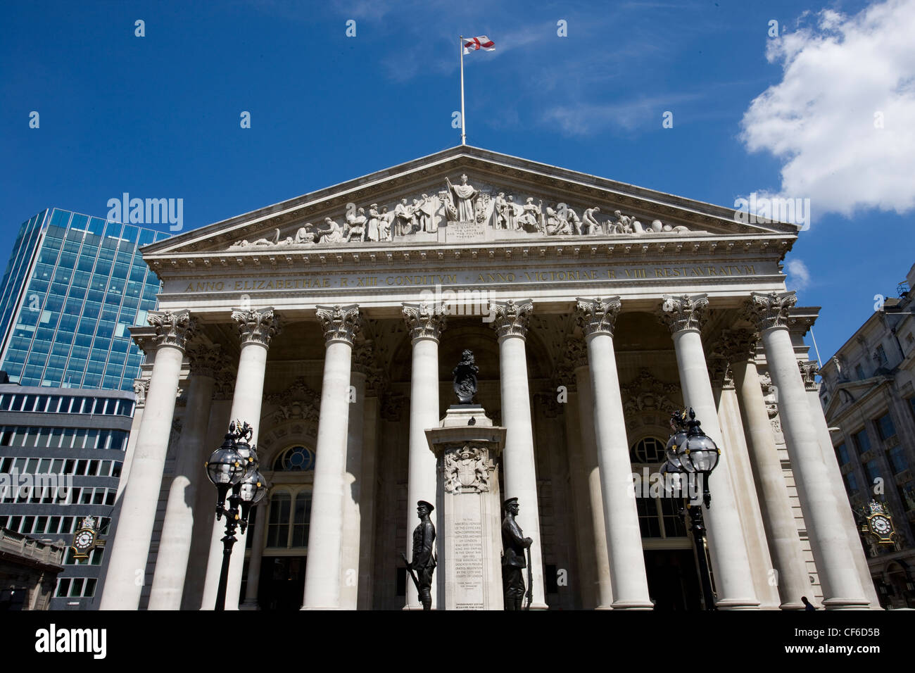 The main entrance of the Royal Exchange, a Grade l listed building, created in 1565 by Sir Thomas Gresham as a place - Stock Image