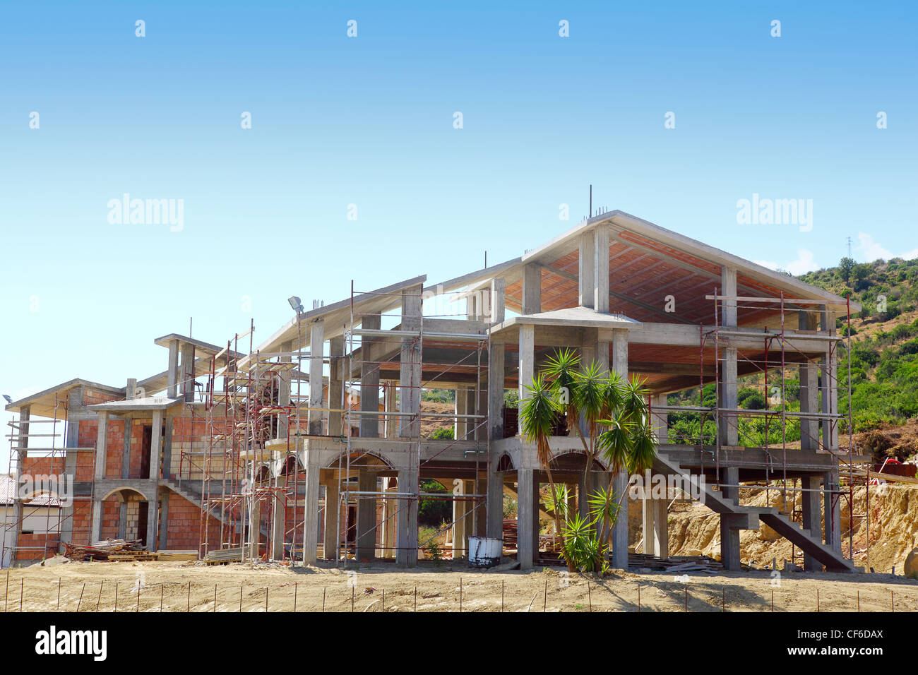 Sceleton of new suburb cottage house with front staircase and palm trees - Stock Image