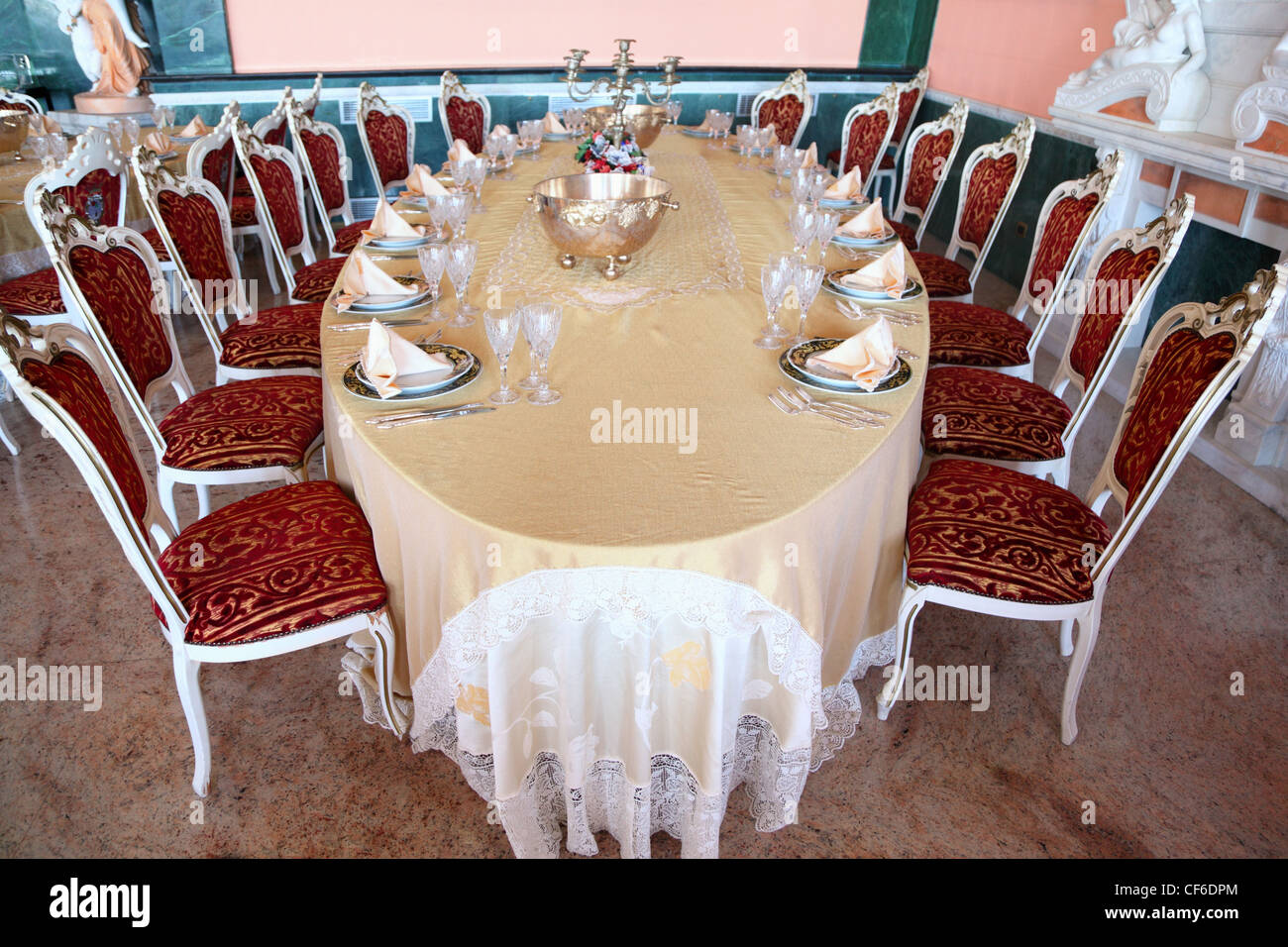 Big Oval Dinner Table With Candlestick, Copper And Empty Dishes: Plates  With Placemat,