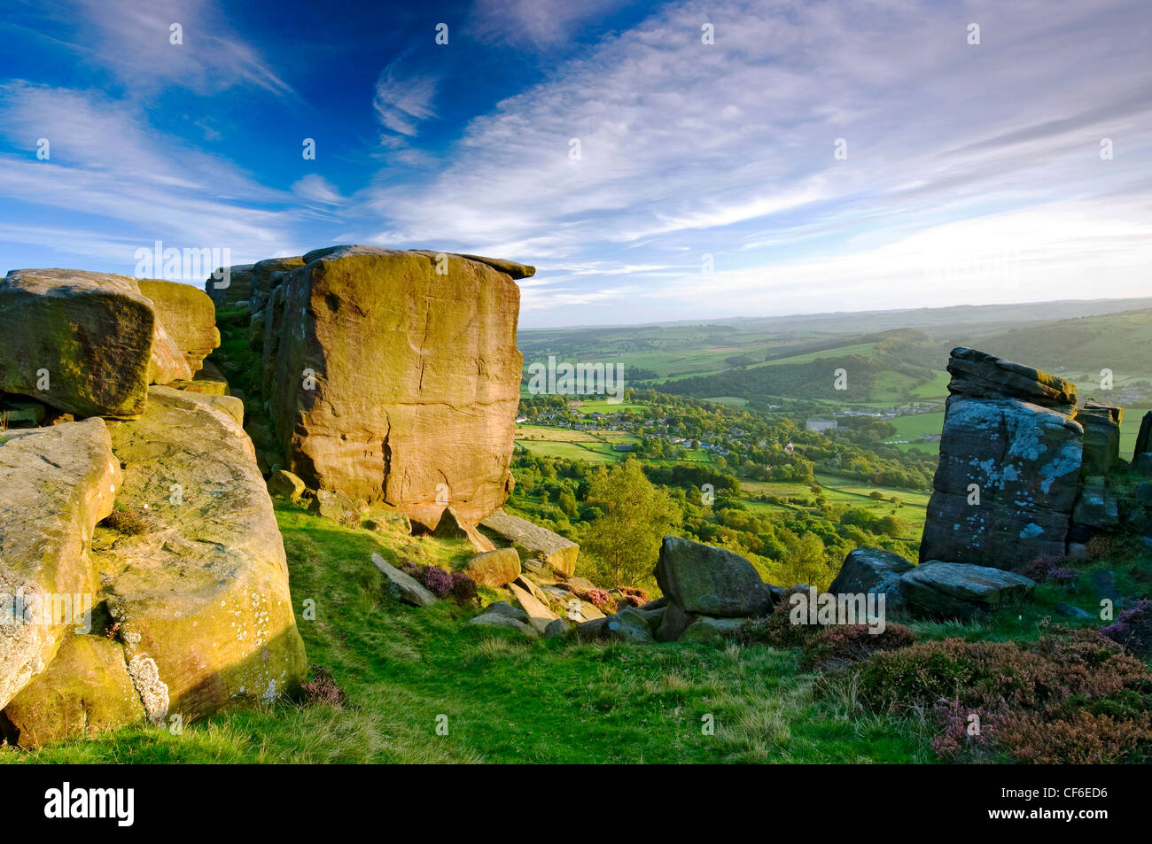 View from Curbar Edge, a gritstone escarpment in the Dark Peak area of the Peak District National Park. - Stock Image