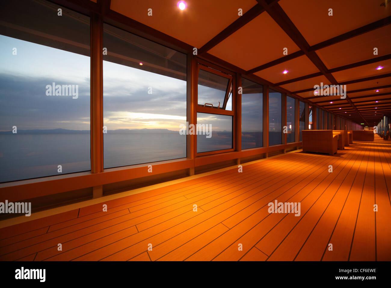 corridor on cruise ship. row of lamps. beautiful view  through window. - Stock Image