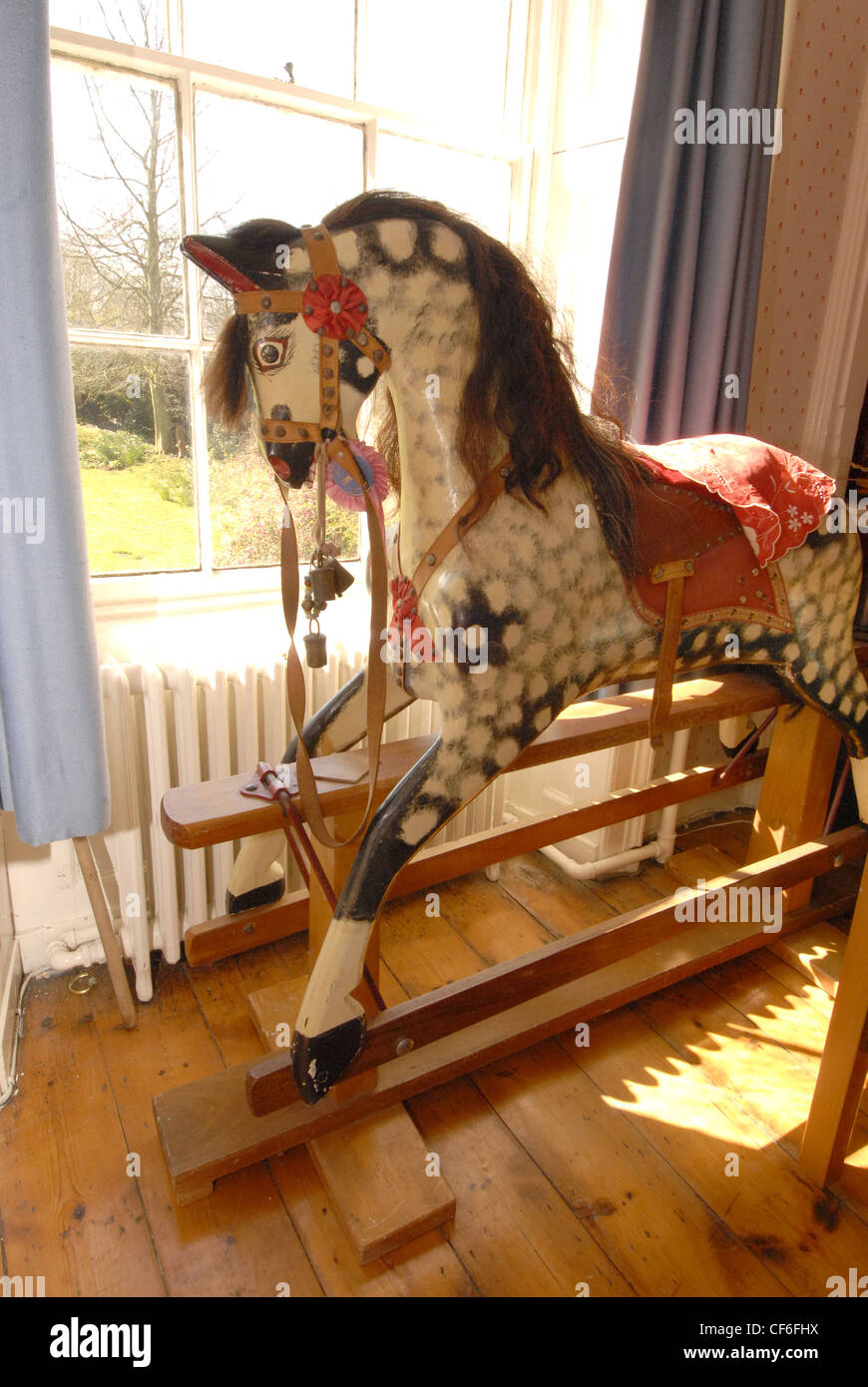 An Old Fashioned Wooden Rocking Horse With Dappled Paint Work Stock