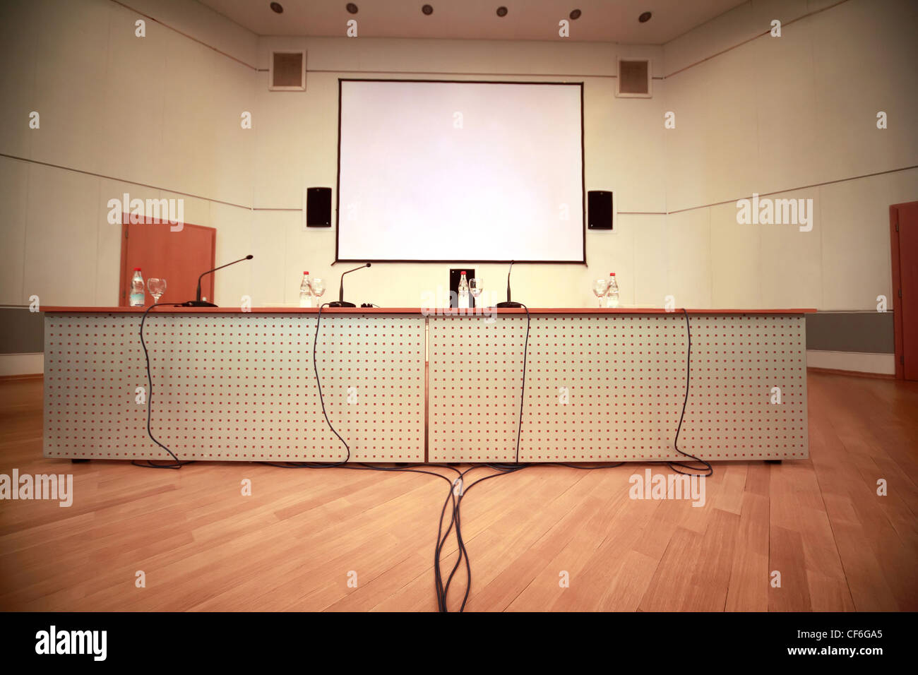 Registration of afloor, walls and table with microphones in conference room - Stock Image