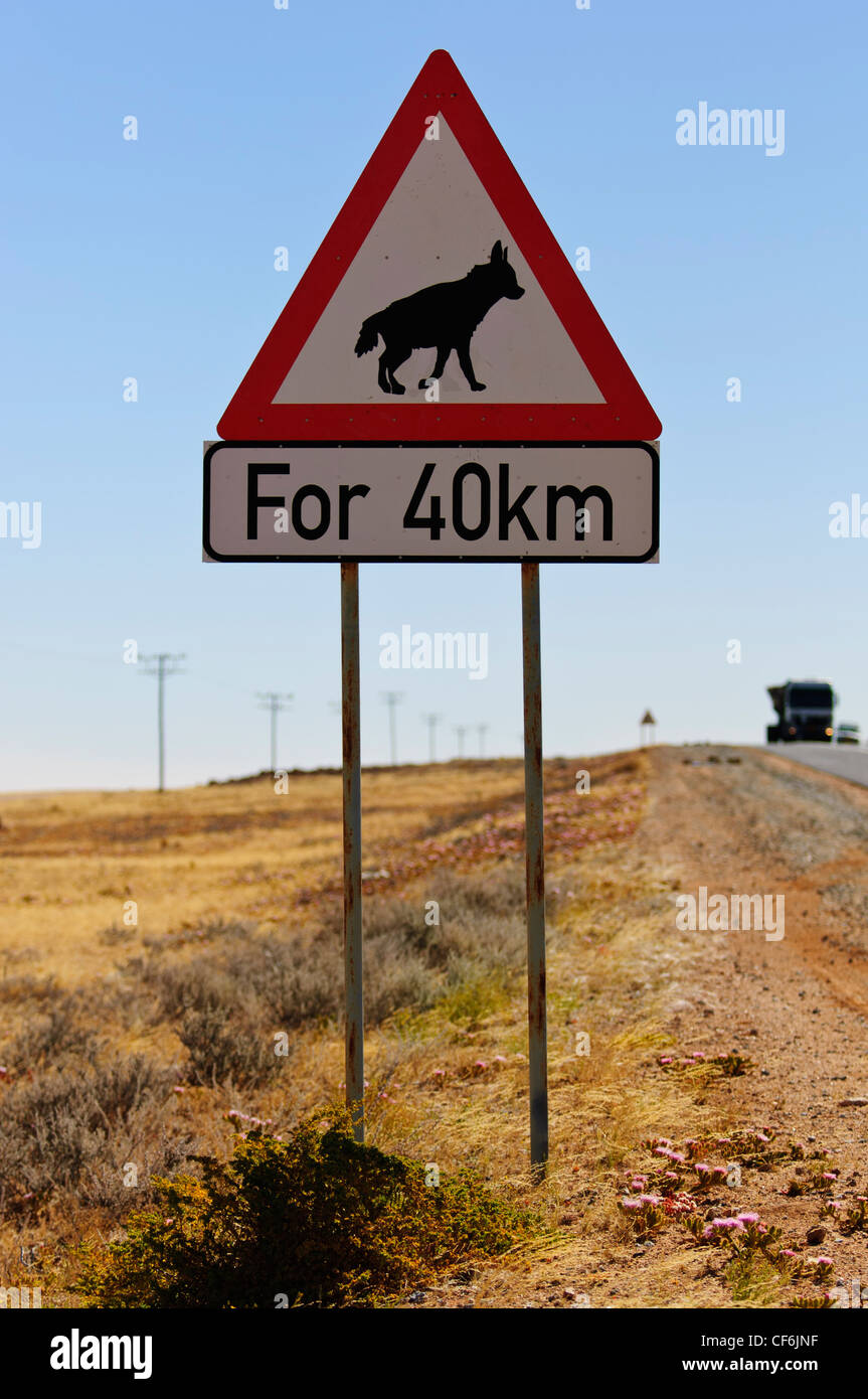 Brown hyena crossing sign along the tarmac road between Aus and Luderitz. Namibia Stock Photo