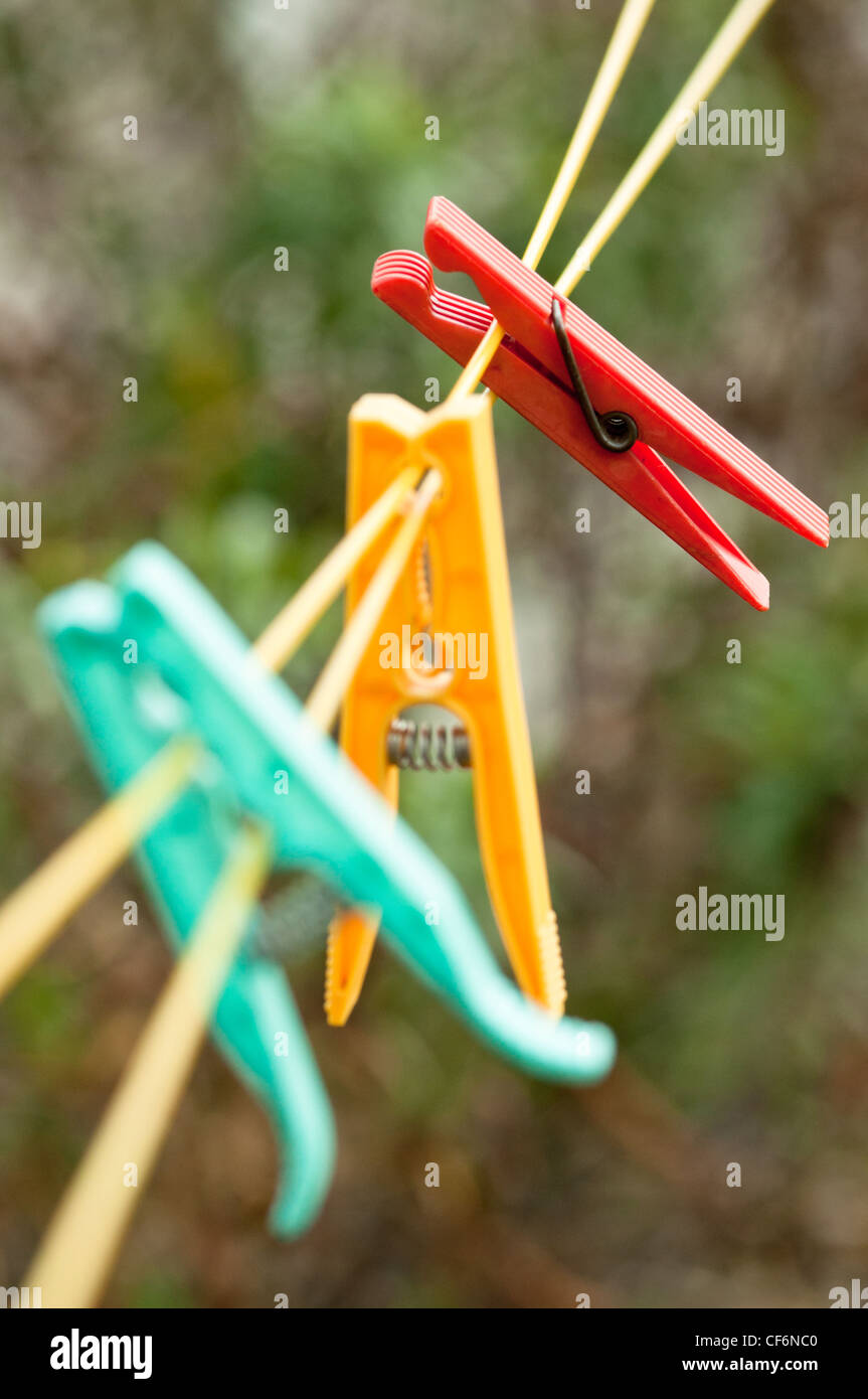Pegs on a clothes line in British garden. Stock Photo